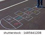 A Young Man Playing Hopscotch...