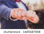 Fists Of Bride And Groom With...