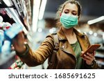 Young woman with face mask...