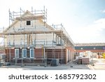 Urk Netherlands 28 March 2020, Empty construction site in the Netherlands with newly build house during the corona or covid 19 outbreak many workers left back to Eastern Europe like Poland - stock photo