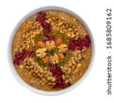 Small photo of Traditional Turkish Dessert Asure - Ashura on white background. Also known as Noah's pudding.