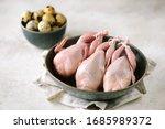 Raw fresh quail birds in a...