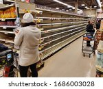 Small photo of Montreal, Canada - March 22, 2020: Empty shelves in grocery store because of COVID-19. Many people around the world have encountered long lines and empty shelves at grocery stores due to coronavirus