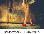 woman legs in red high heel... | Shutterstock . vector #168607016