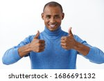 Small photo of Best deal online. Portrait of confident african american man assuring its good, show thumbs-up as recommend, approve or like product, smiling pleased, give satisfactory opinion, white background
