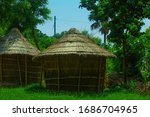 Small photo of asian style nature surrounded huts. hut between trees. huts standing alone. north indian uttarpradesh style hut