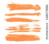 set texture orange paint smears ... | Shutterstock .eps vector #168673886