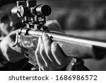 Hunter with Powerful Rifle with Scope Spotting Animals. Hunter with shotgun gun on hunt. Hunter in the fall hunting season - stock photo