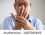 asian old man sitting on sofa... | Shutterstock . vector #1687060645