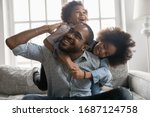 Happy African Family At Home ...
