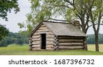 An Old Log Cabin Perched On A...
