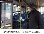 Man In Face Mask In A Buss...