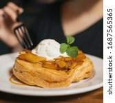 Small photo of Apple strudel with a scoop of ice cream and mint