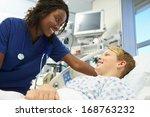 Boy Talking To Female Nurse In...