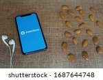 Small photo of Mexico City, Mexico - March 30, 2020; Mention Apple Application on IPhone Screen on a Rustic Textile with Earphone and Almonds. Mention is a social media tool. #Mention