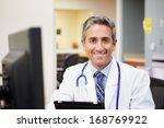 portrait of doctor working at... | Shutterstock . vector #168769922