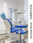 Vertical view of a dentist seat and equipment - stock photo