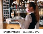 A Female Waiter Of European...