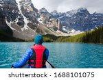 Girl Canoeing On Moraine Lake...