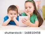 happy children using tablet... | Shutterstock . vector #168810458