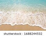 Wave Of Blue Ocean On Sandy...