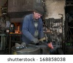 Blacksmith Works In A Small...