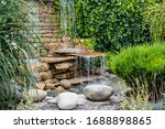 A Small Decorative Waterfall In ...