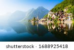 Small photo of Scenic panoramic view of famous Hallstatt lakeside town reflecting in Hallstattersee lake in the Austrian Alps in scenic morning light on a beautiful sunny day in summer, Salzkammergut region, Austria