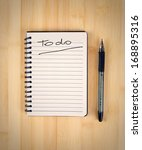 to do list on the wooden table | Shutterstock . vector #168895316