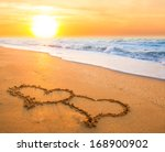 Two Hand Drawn Hearts On Beach...
