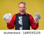 Happy Elderly Business Man Wit...