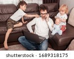 Young Busy Father Trying To...