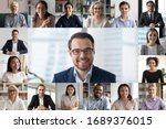 Small photo of Headshot screen application view of diverse multiracial employees have work web conference using modern platform, smiling multiethnic colleagues talk speak online brainstorm on video call