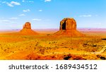 The sandstone formations of West Mitten Butte and Merrick Butte in the desert landscape of Monument Valley Navajo Tribal Park in southern Utah, United States