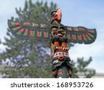 totem pole topped  by... | Shutterstock . vector #168953726