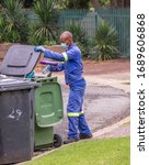 Small photo of Alberton, South Africa - March 31, 2020: unidentified council workers from the Ekurhuleni Metro Council perform essential services during the covid-19 lockdown in the country