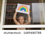 Kid Painting Rainbow During...