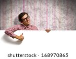 man holding a banner in front...   Shutterstock . vector #168970865