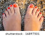 Fingers Wet Sand At The Feet O...