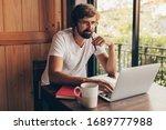 pensive man with beard using... | Shutterstock . vector #1689777988