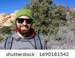 Smiling Man Tourist Backpacker...