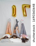 Small photo of Three cheerful pretty girls celebrating birthday. Seventeen number balloons.