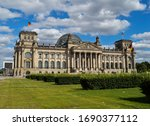 Reichstag building, where the German parliament is (Bundestag) with a blue and cloudy sky in Mitte district, Berlin, Germany