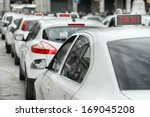 row of white taxi | Shutterstock . vector #169045208