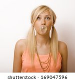 Pretty Blond Woman Blowing Gum...