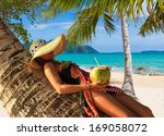 beautiful woman with straw hat... | Shutterstock . vector #169058072
