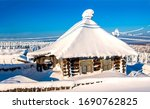 Snow covered village hut in...