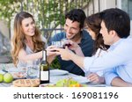 happy young friends eating... | Shutterstock . vector #169081196