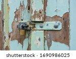 Unlocked Padlock On An Old...