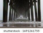 Under The Pier On A Foggy...